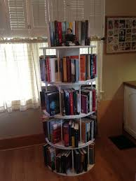 The rotating bookshelf my husband made from wire spools from work!