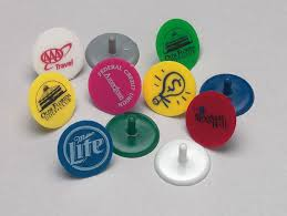 ball markers. personalised plastic golf ball markers