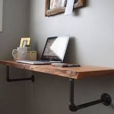 Perfect for stylish space-savers, this minimalist, wall-mounted live edge  desk