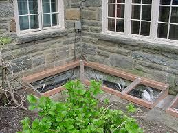 Brick basement window wells Decorating Masonry Or Wood Window Well Cover 5r Corner Well The Window Bubble Masonry And Wood Window Wells Window Well Covers Window Bubble