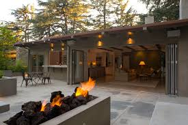 indoor and outdoor living with bi fold patio doors a fire pit