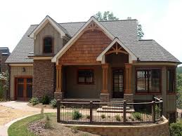 rustic house design with shake stone and vertical siding