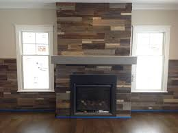 pictures of fireplace made with pallets in chevron pattern google search wood fireplace surroundspallet fireplacereclaimed