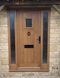 european oak framed ledged door with vision panel and frame with fully glazed sidelights fl16 frame sizes 1400mm wide x 2095mm high door width 838mm