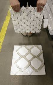 my other favorite was this combination of carrara lattice marble mosaic paired with this gray and white flower marble mosaic i plan on doing gold hardware