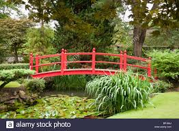 Japanese Style Garden Bridges Red Bridge Over A Pond In A Formal Japanese Garden At The National