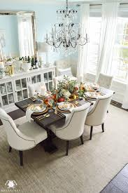 thanksgiving dinner table ideas gold pottery barn table setting with fruits veggies flowers and eucalyptus elegant blue dining room with crystal