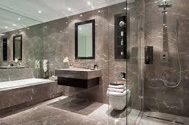 A Muted Marble Bathroom With Dark Oak Inset Storage And Walkin - Hill house interior