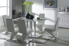 fresh centerpiece on top dining table around cool design white leather dining room chairs on fur rug and picture closed modern credenza on sleek floor model