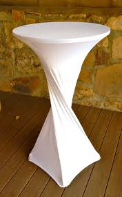 small and high round cocktail table with custom white spandex covers in the patio with hardwood floor tiles ideas