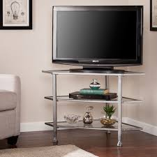 southern enterprises jaymes distressed silver metal and glass corner tv stand hover to zoom