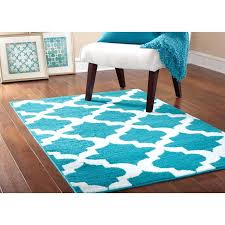 orange and white area rug blue area rugs on dark flooring with white baseboard and parsons orange and white area rug