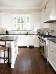 white country kitchens. WHITE COUNTRY #KITCHEN WITH BLACK COUNTER TOPS AND WOOD FLOOR . White Country Kitchens