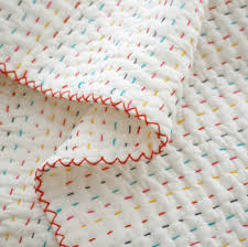 Making An Easy Handmade Baby Quilt | Young House Love & I love how charming that sweetly imperfect hand-done stitching is. Each  line is irregular enough to clearly not be machine-made, and it feels so  full of ... Adamdwight.com