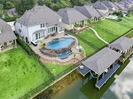 infinity pool backyard. Clear Lake Real Estate: A Backyard Oasis With Infinity Pool-0 Pool