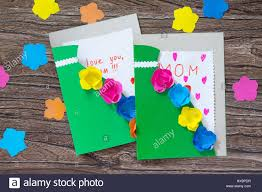 Mothers Greeting Card A Child Is Holding A Greeting Card With Flowers On Mothers Day