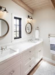 choosing lighting. when choosing fixtures for a bathroom sneed prefers fourinch lighting