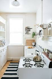 Small Kitchen Apartment A Sweet Small And Organized Kitchen Stove White Rug And Tiny
