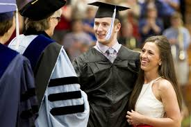paralyzed college student chris norton walks across stage at chris norton walks across the stage to collect his diploma