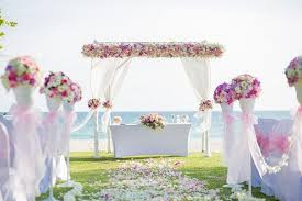 wedding archway and decorations on the beach wedding flower wall