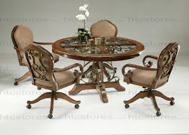 pastel furniture carmel 5 piece round wood with glass insert dining set with carmel caster chairs