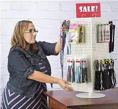 counter pegboard display with chrome hooks w rotating design