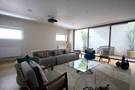 Natural lighting in homes Curved Roof Limitlessltdnaturallightsystemsbasementlivingroom Basement Waterproofing Association Basement Conversions And Natural Light From Limitless Ltd
