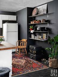 kitchen with oriental rug and open shelving