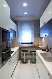 Stylish Small Modern Kitchen With Eat In Counter. Cabinets And Floor In  White With