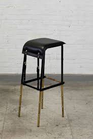 Jacques Adnet, Set of Six Black Leather Stools | From a unique collection  of antique