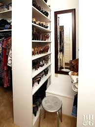 walk in closet design ideas just build a wall raise partition that brings utility to small this bookcase divider handily holds shoes galore and images