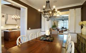 feng shui dining room wall color. modern dining room decorating with wooden furniture and metal chandelier, natural materials brown colors for good feng shui interior wall color
