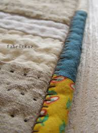 zakka binding... ***love the mixture of fabrics on the binding and ... & blanket stitch binding - very unique idea! Hand stitch binding, then stitch  in the ditch to attach! Adamdwight.com