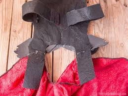showing the underside of thor s armor where the felt is safe pinned to the red cape