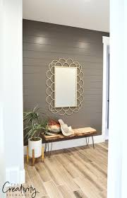 painted shiplap accent wall in hallway