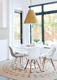 modern white pedestal dining table room ideas with round design 18