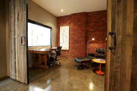 brick wall and sliding barn door for the home office in revamped warehouse residence design architects sliding door office