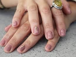 gold studded mauve nails
