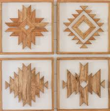 katie from addicted 2 diy out did herself with this group of 4 aztec inspired pieces of wood wall art she nailed all those miters