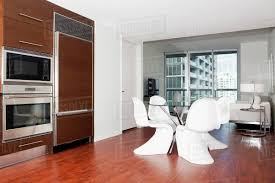 Dining Table Oven And Cabinets In Modern Kitchen Stock Photo