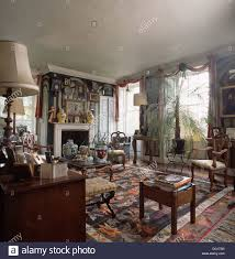 Potted palm in old fashioned drawing room with patterned carpet