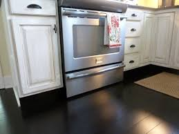 image of white kitchen cabinets with dark hardwood floors authentic