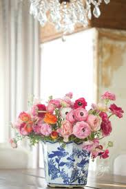 Beautiful table centerpiece - red and pink flowers in a blue and white  chinoiserie vase.