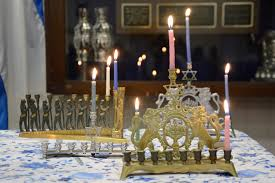 lighting the menorah for the first day of hanukkah