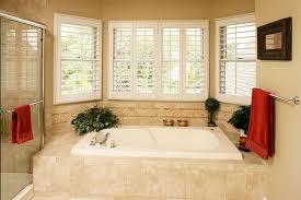 great window treatments above a bathtub