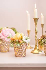 fill this bud vase with wildflowers and roses for your wedding centerpieces complement the metallic