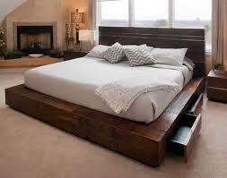 Rustic meets modern in this contemporary platform bed design. Using  reclaimed woods & stainless steel