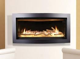 kozy heat fireplaces heat curved contemporary direct vent fireplace shown with driftwood log set and glass