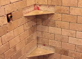 remember when installing the shelves you want them to slope down so ceramic tile shower corner
