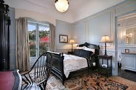 gold leaf design bedroom mediterranean with light blue wainscoting black side chair